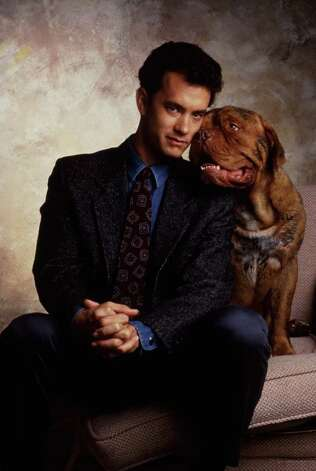 """Turner and Hooch"" - Tom Hanks stars as fastidious detective Scott Turner, who's saddled with a slobbering new partner: a dog named Hooch. The pup's previous owner was killed, and he and Turner team up to collar the culprit. Available Aug. 1 / handout"