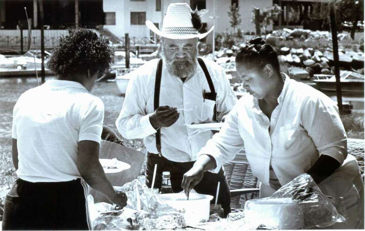 July 4, 1986: Edmund Pinn, center, looks at some fixings while Sharon Orr, left, and Marcia Marable help themselves at their picnic at Cummings Park.