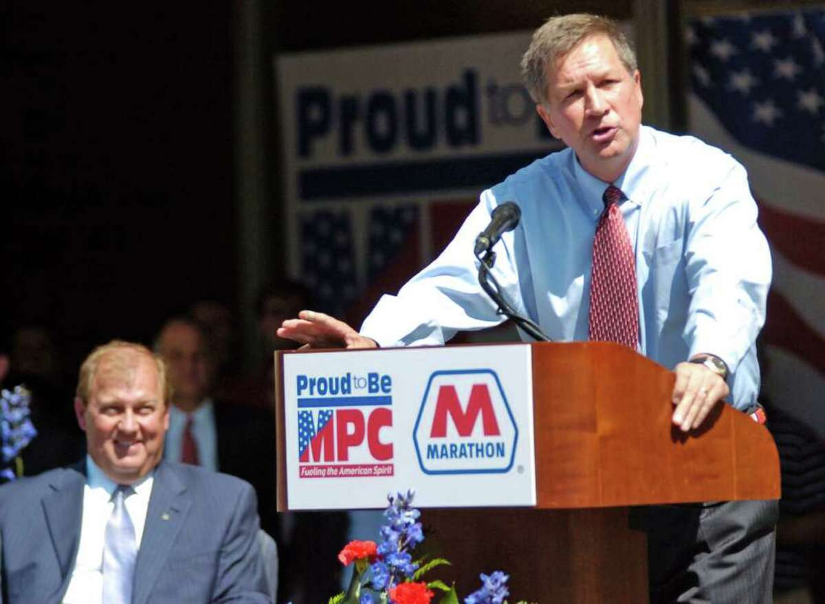 Ohio Gov. John Kasich, right, speaks at a spinoff celebration at the Marathon building in Findlay, Ohio, Thursday, June 30, 2011. Marathon Petroleum CEO and president Gary Heminger is on the left.