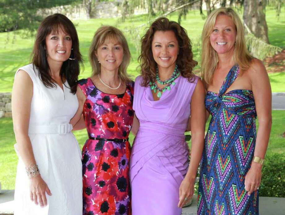 Actress-singer Vanessa Williams, second from right, was one of the main speakers at the Rose of Hope Luncheon and posed with the three chairs of the fundraiser. From left are Linda Blackwell, Donna Twist, Williams and Daneen Grabe. Photo: Contributed Photo / Fairfield Citizen contributed