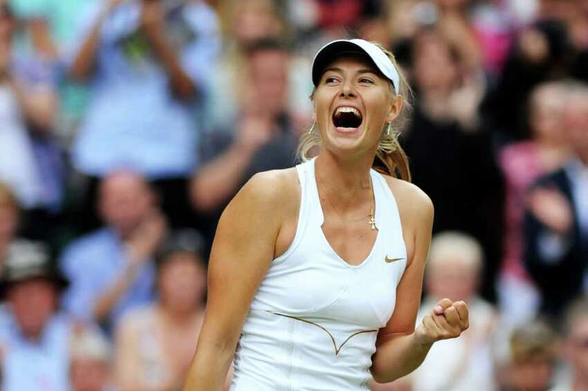 LONDON, ENGLAND - JUNE 30: Maria Sharapova of Russia celebrates after winning her semifinal round match against Sabine Lisicki of Germany on Day Ten of the Wimbledon Lawn Tennis Championships at the All England Lawn Tennis and Croquet Club on June 30, 2011 in London, England. (Photo by Clive Mason/Getty Images)