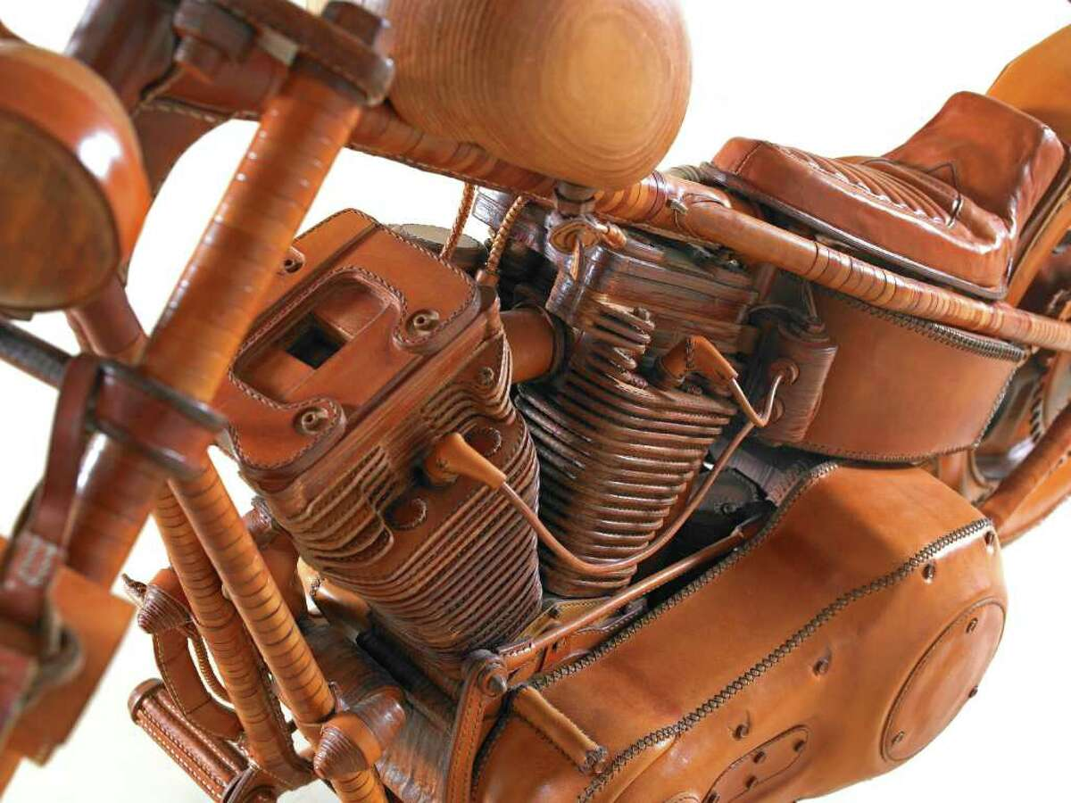 This photo provided June 22, 2011, by The Harley-Davidson Motor Company shows a chopper made entirely from leather at the Harley-Davidson museum in Milwaukee. The chopper is one of several hundred pieces at a new exhibit,