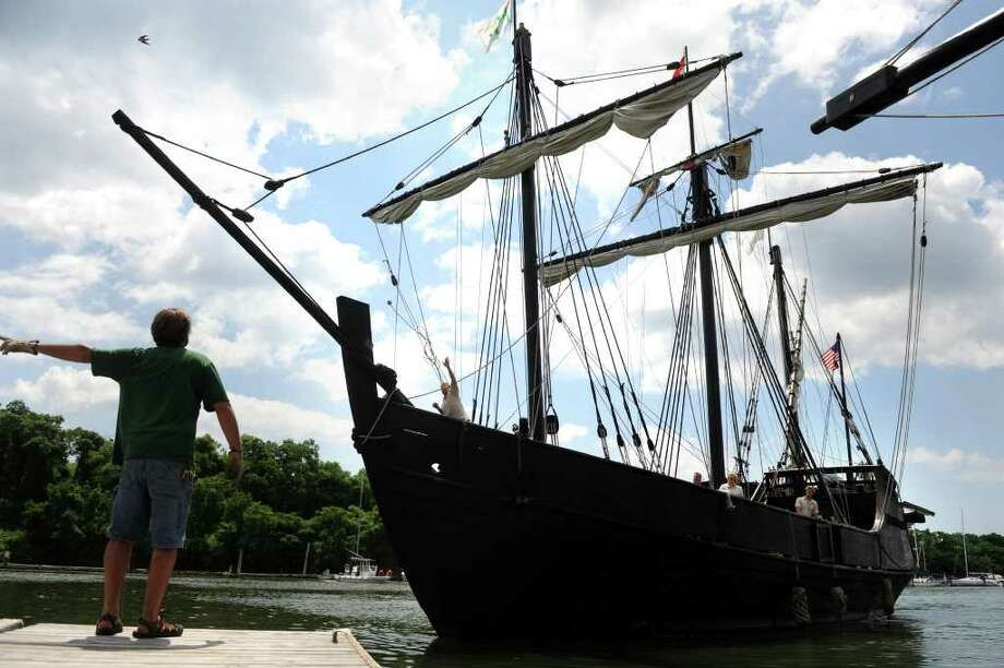 Brad Williams directs a replica of Columbus' ship, the Pinta, into the dock Thursday, June 30, 2011 at Captain's Cove Marina in Bridgeport, Conn. Photo: Autumn Driscoll / Connecticut Post
