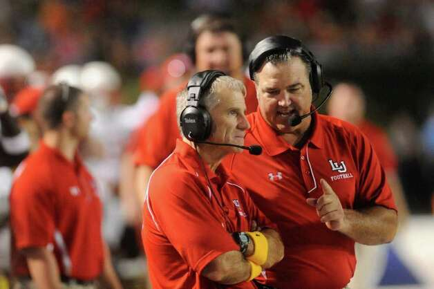 Lamar defensive coordinator Roger Hinshaw, left, and linebacker coach Craig McGallion work from the sidelines during the first half matchup against McNeese State at Cowboy Stadium in Lake Charles on Saturday, September 4, 2010  Valentino Mauricio/The Enterprise / Beaumont