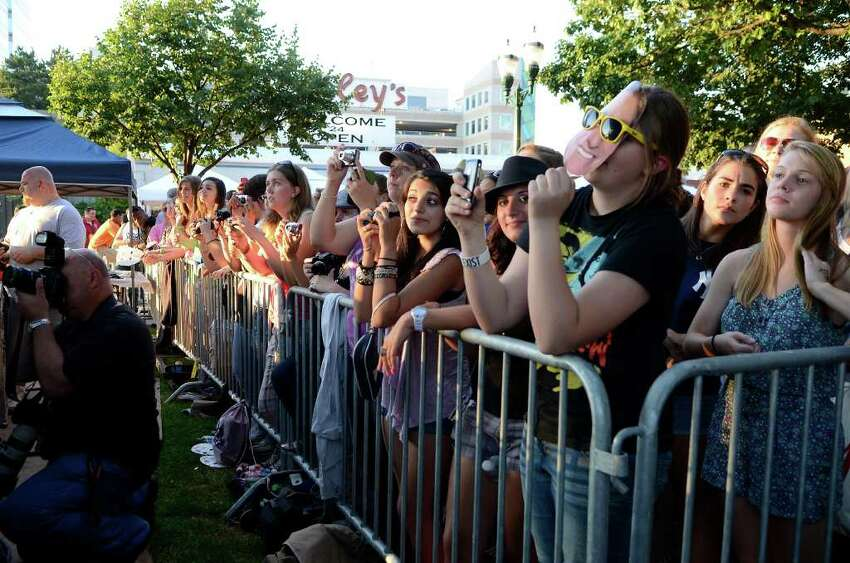 Spectators enjoy an Alive@Five performance, this one headlined by American Idol winner Lee Dewyze, in Columbus Park in downtown Stamford, CT on Thursday, June 30, 2011.