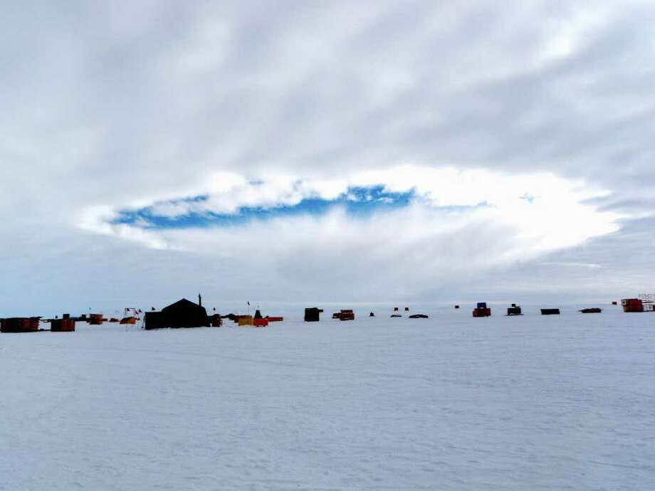 This handout photo, taken Dec. 12, 2009, provided by the journal Science shows an aircraft-induced hole observed at the West Antarctic Ice Sheet Divide Camp, Antarctica. Airplanes flying through supercooled clouds around airports can cause condensation that results in more snow and rain nearby, according to a new study. The correct conditions for this inadvertent weather modification occur about five percent of the time _ but 10-to-15 percent in winter _  according to Andrew J. Heymsfield of the National Center for Atmospheric Research in Boulder, Colo., lead author of the study appearing in Friday's edition of the journal Science. (AP Photo/ Eric Zrubek and Michael Carmody, Science) Photo: Eric Zrubek And Michael Carmody.