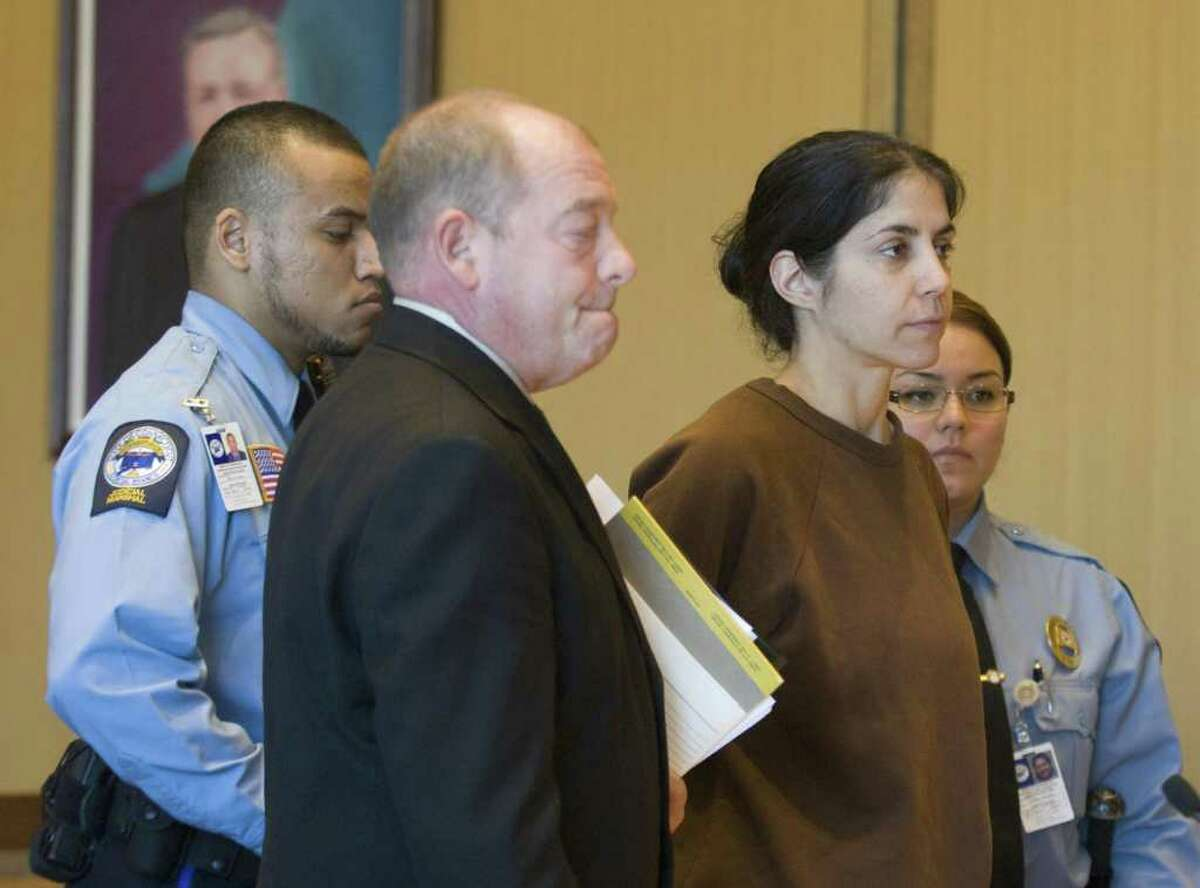 FILE - Sheila Davalloo, right, is arraigned for the murder of Anna Lisa Raymundo at Superior Court at Stamford in Stamford, Conn. on Tuesday, Dec. 30, 2008. Public Defender Barry Butler, is at center.