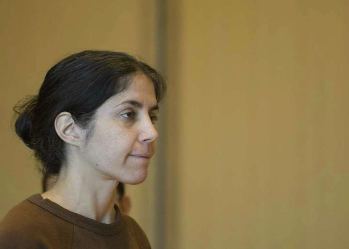 FILE - Sheila Davalloo is arraigned for the murder of Anna Lisa Raymundo at Superior Court at Stamford in Stamford, Conn. on Tuesday, Dec. 30, 2008.