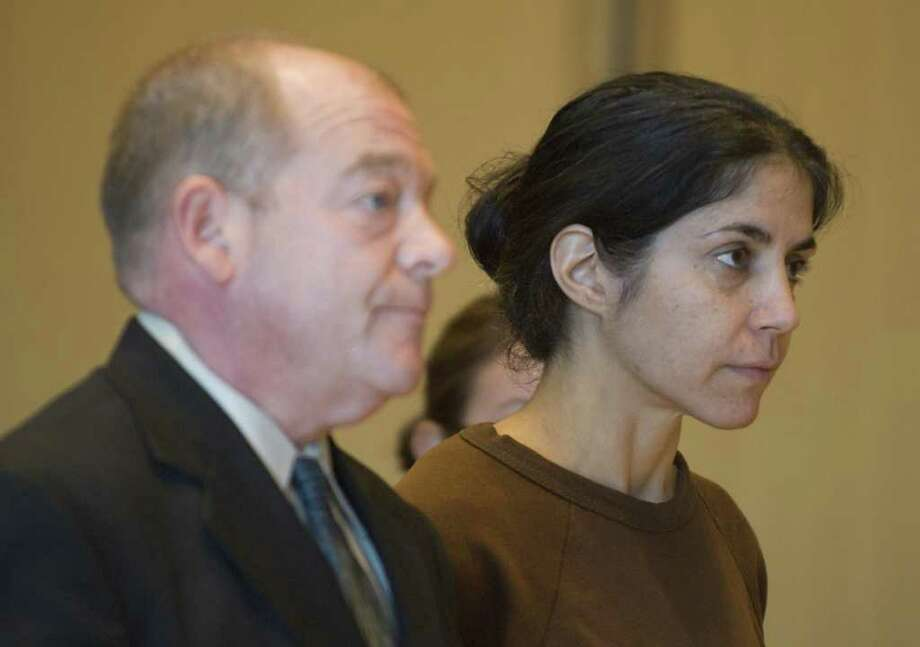 FILE – Sheila Davalloo is arraigned for the murder of Anna Lisa Raymundo at Superior Court at Stamford in Stamford, Conn. on Tuesday, Dec. 30, 2008. Public defender Barry Butler is at left. Photo: File Photo / Stamford Advocate File Photo