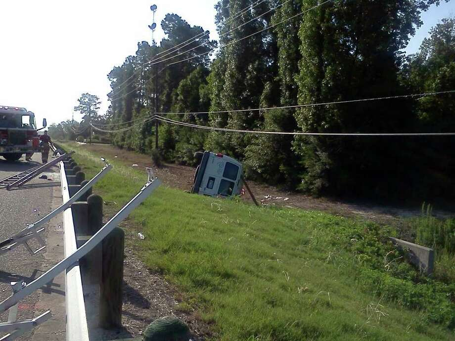 The driver of a Time Warner Cable van was hospitalized with life-threatening injuries after a rollover wreck on FM 1442. Jessica Lipscomb/The Enterprise