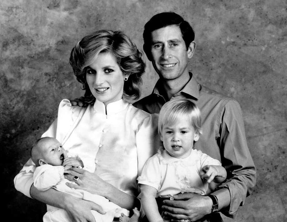 The Prince and Princess of Wales, Prince Charles and Princess Diana, pose for a family portrait with their sons, Prince William, right, and Prince Harry, at the Kensington Palace in London, England on Oct. 6, 1984. Prince Harry was born on Sept. 15.  Prince William was born June 21, 1982. / AP1984