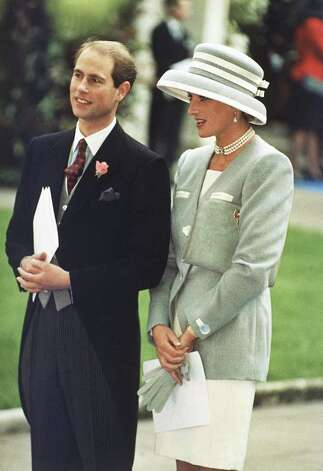 Britain's Prince Edward and Princess Diana, the Princess of Wales, watch the departure of Viscount Linley, the nephew of Britain's Queen Elizabeth, and Serena Stanhope, daughter of Viscount Petersham, who were married at St. Margaret's Church, in London, on Oct. 8, 1993. The wedding was attended by 350 friends and relatives including members of the British Royal family. (AP Photo/Allen) Photo: Gill Allen, STF