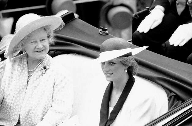 Britain's Queen Elizabeth, the Queen Mother, and Diana, Princess of Wales drive in an open carriage down the Ascot race course  as they arrived on June 18, 1985, for the start of the Royal Ascot race meeting, the first day of the four-day meeting. (AP Photo/Dave Caulkin) Photo: Dave Caulkin, STF