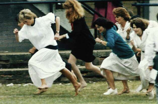Britain's Princess Diana (white dress, left) storms away from the field at the start of the mothers race, held during a sports day for Wetherby school, where her son Prince William is a pupil. The race was held at the Richmond Rugby Club, in Surrey, just south of London on Tuesday, June 28, 1989. Diana, who led all they way, was just beaten on the finish line into second place. (AP Photo) Photo: Anonymous, STR