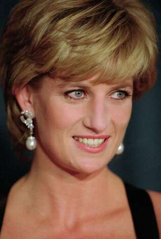 In this Dec. 11, 1995 file photo, Diana, Princess of Wales, smiles at the United Cerebral Palsy's annual dinner at the New York Hilton. Princess Diana would have been 50 years old on Friday, July 1, 2011, perhaps the only certainty about the course of a life abruptly cut short in a 1997 car crash in Paris, with a new boyfriend, two months past her 36th birthday. (AP Photo/ Mark Lennihan,file) Photo: MARK LENNIHAN, STF / AP1995