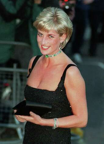 In this July 1, 1997 file photo, Princess Diana smiles as she arrives at the Tate Gallery in London, to attend the Centenary Gala honoring the world famous museum. Princess Diana would have been 50 years old on Friday, July 1, 2011, perhaps the only certainty about the course of a life abruptly cut short in a 1997 car crash in Paris, with a new boyfriend, two months past her 36th birthday. (AP Photo/Jacqueline Arzt, file) Photo: JACQUELINE ARZT, STF / AP1997