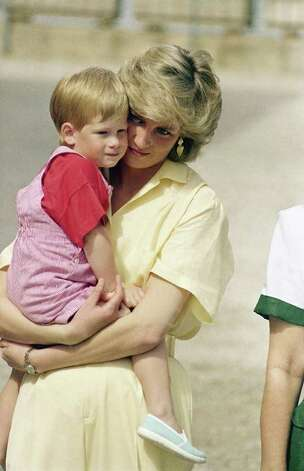 The Princess of Wales holds son Prince Harry while royal families posed for photographers at the Royal Palace, Majorca, Spain on Sunday, August 9, 1987. Prince Charles and Princess Diana with their two children William and Henry are spending a week's vacation on the island as guests of King Juan Carlos and his family. (AP Photo/John Redman) Photo: JOHN REDMAN, STF