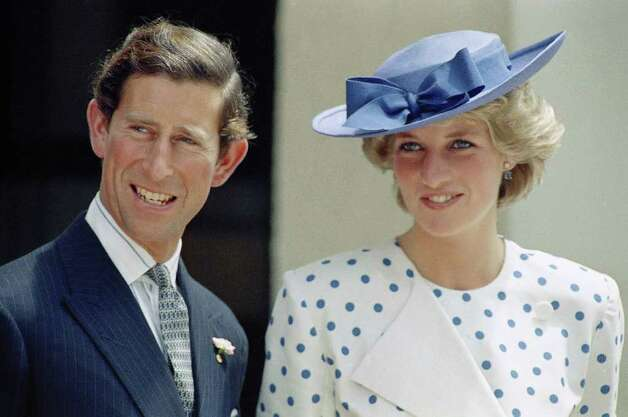 Prince Charles with his wife Princess Diana in front of Lodge Canberra, Australia, on Nov. 7, 1985. (AP Photo)