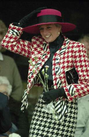 Princess Diana, Princess of Wales wearing large dog patterned red, white and black jacket and skirt smiles as she struggles to keep her from blowing off after ending the christening Princess Eugenie Victoria, the youngest daughter of the Duke and Duchess of at Sandringham Church Day in Sandringham, England on Dec. 23, 1990. Nine month-old Prince Eugenie is a niece of princess of Wales. (AP Photo) Photo: Anonymous, STF