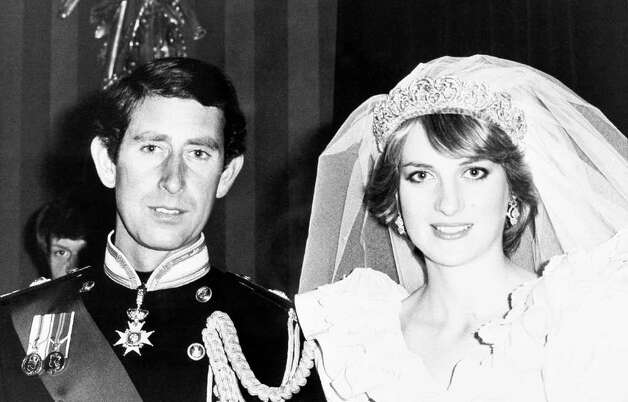 Prince Charles and the Princess of Wales waiting for their wedding portrait in Buckingham Palace in London on July 29, 1981 after their wedding at St. Paul's Cathedral. (AP Photo/Press Association)
