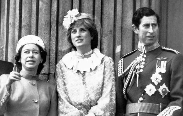 Princess Margaret, left, with Prince Charles and his fiancee Lady Diana Spencer on the balcony at Buckingham Palace in London on June 14, 1981 as they watched the Royal Air Force fly past after the dramatic events of the Trooping the Color ceremony. (AP Photo/Press Association)