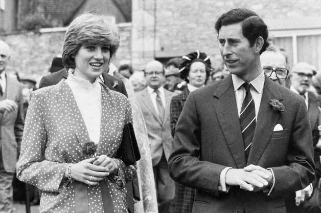 "Prince Charles and his bride-to-be, Lady Diana Spencer holding a single flower, during their visit to Tetbury on May 22, 1981. Thousands turned out to greet their ""neighbors"" on the visit to the Cots old town. (AP Photo/Press Association)"
