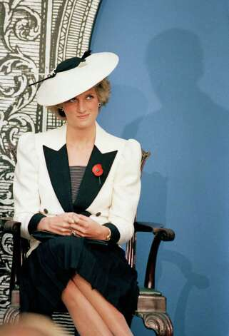 Diana, the Princess of Wales, casts a glance at her husband Prince Charles as he speaks at a press conference at the National Gallery of Art, in Washington, Nov. 10, 1985. (AP Photo/Bob Daugherty) Photo: Bob Daugherty, STF