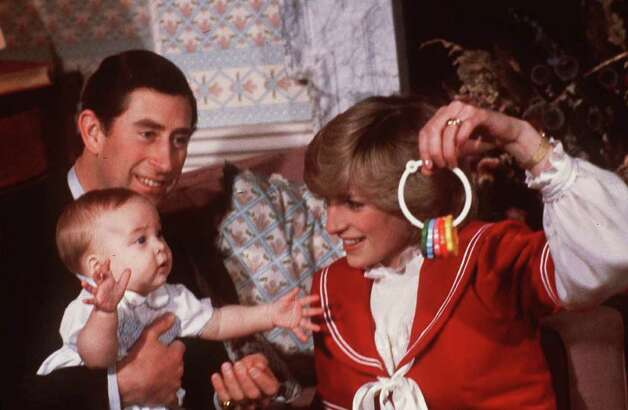 Princess Diana and Prince Charles are shown with their son Prince William during a photo session at Kensington Palace in London in December 1982. Britain s Princess Diana, who had been struggling to build a new public and private life after her turbulent divorce, was killed Sunday, Aug. 31, 1997, along with her companion, Dodi Fayed, and the driver of the car in Paris. (AP Photo/file)