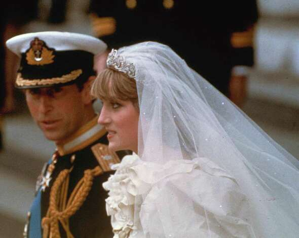 Prince Charles and his bride Diana, Princess of Wales, march down the aisle of St. Paul's Cathedral at the end of their wedding ceremony on July 29, 1981 in London. (AP Photo)