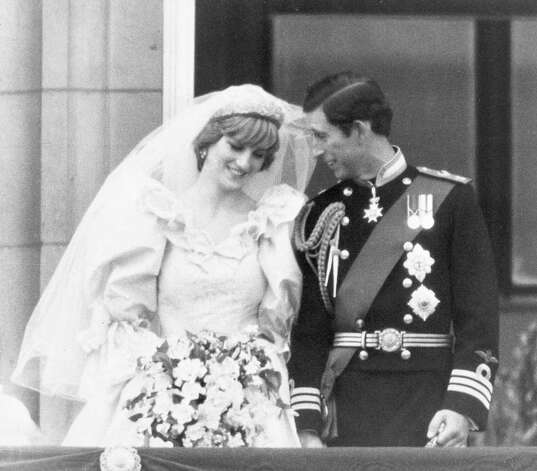 A shy Diana, Princess of Wales, and Prince Charles on the balcony of Buckingham Palace after their wedding at St. Paul's Cathedral, July 29, 1981, in London.  (AP Photo)