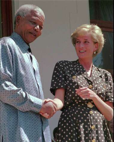 South African President Nelson Mandela, left, shakes hands with Princess Diana in Cape Town, Monday, March 17 1997.  Princess Diana met with Mandela to discuss the threat of AIDS in South Africa. (AP PHOTO/Sasa Kralj) Photo: SASA KRALJ, STR / AP1997
