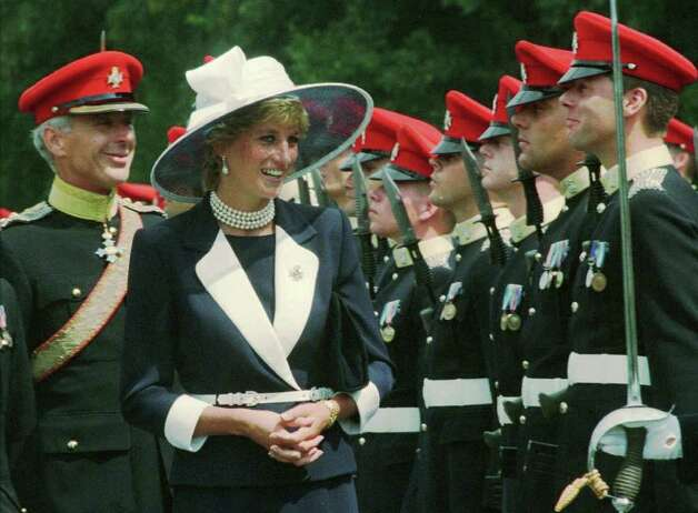 The Princess of Wales reviews the honour guards before presenting the new colours to the Light Dragoons, the regiment of which she is Colonel-in-Chief,in Bergen, northern Germany, on Saturday, July 22, 1995. The Light Dragoons are part of the 23,000 strong 1st Armoured Brigade. At left is the regiment's commander Lnt. Col. Robert Webb-Bowen. (AP Photo/Christof Stache) Photo: CHRISTOF STACHE, STR / AP1995