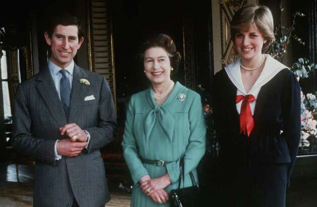 Lady Diana Spencer and Prince Charles pose with  Queen Elizabeth II, center, in Buckingham Palace in March 27, 1981, after the queen gave her formal consent to the couple for marriage. (AP Photo) Photo: Anonymous, HO