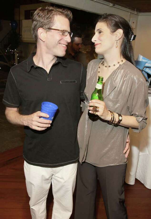 Saratoga Springs, NY - June 23, 2011 - (Photo by Joe Putrock/Special to the Times Union) - Daniel Moss(left) and Serena Savage(right) during Project Lift University, a benefit for Franklin Community Center's Project Lift presented by Saratoga Springboard. Photo: Joe Putrock / Joe Putrock