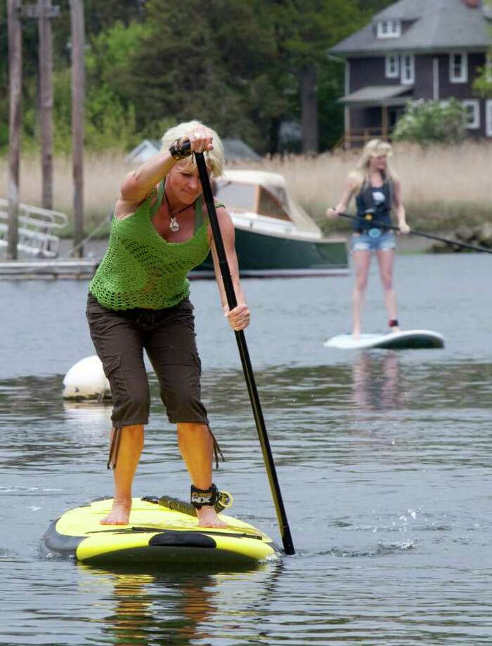 Paddleboarding involves standing on a flat board and rowing with a uniquely designed paddle. Photo: Wendy Carlson / Healthy Life