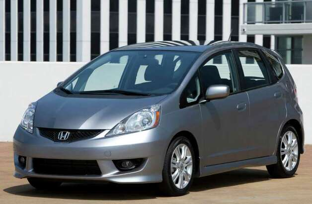 "Kelley says of its No. 4 choice: ""Fun, flexible and funky, the Honda Fit remains an instantly unanimous choice for our annual cool cars list.  Even the crisper, better-equipped Fit Sport comes in under our $18,000 ceiling."" Photo: COURTESY OF AMERICAN HONDA MOTOR CO. / Honda"