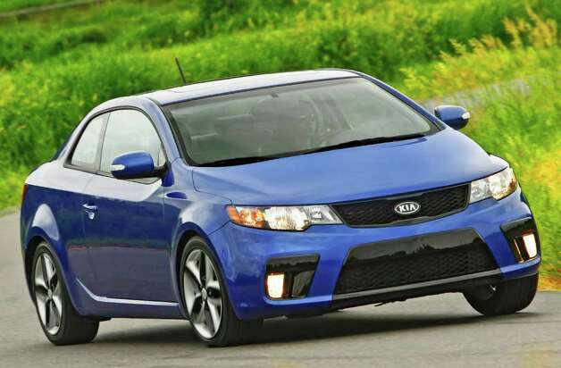 The 2011 Forte Koup is yet another pleasant surprise from Kia, which lately has been reinventing itself as one of the coolest car companies ever. It came in at No. 5 on Kelley's list of the Top 10 Coolest Cars Under $18,000. Photo: COURTESY OF KIA MOTORS AMERICA