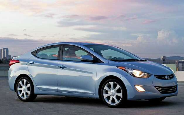 "The redesigned 2011 Hyundai Elantra compact sedan rounded out Kelley's list of the Top 10 Coolest Cars Under $18,000, coming in at No. 10. ""Who knew good value could be so cool? The all-new 2011 Hyundai Elantra is an all-around package of slick design, convenient features and fuel-efficiency — every Elantra gets 40 miles per gallon on the highway,"" Kelley said. Photo: COURTESY OF HYUNDAI MOTOR AMERICA"