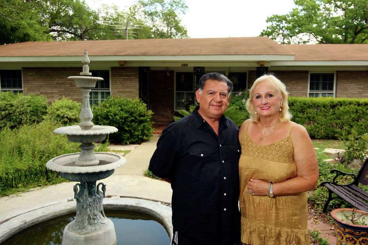 Arturo  (left) and Jimmie Suarez moved into their Castle Hills home 13 years ago, liking the privacy the large lots give.