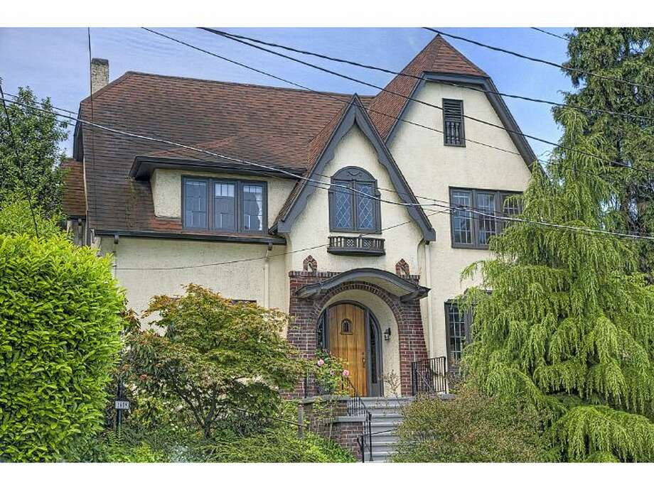 This 1926 Tudor home is on the market for the first time in 50 years. The house, at 1609 22nd Ave. E., in Capitol Hill, features scads of exposed wood moldings and built-ins, old-school chandeliers, radiators and an elevator. The house is 2,800 square feet, with four bedrooms and 2.25 bathrooms, sits on a 3,948-square-foot lot and is listed for $820,000. (Listing: www.windermere.com/index.cfm?fuseaction=listing.PP3ListingDetail&ListingID=130321793) Photo: Windermere Real Estate