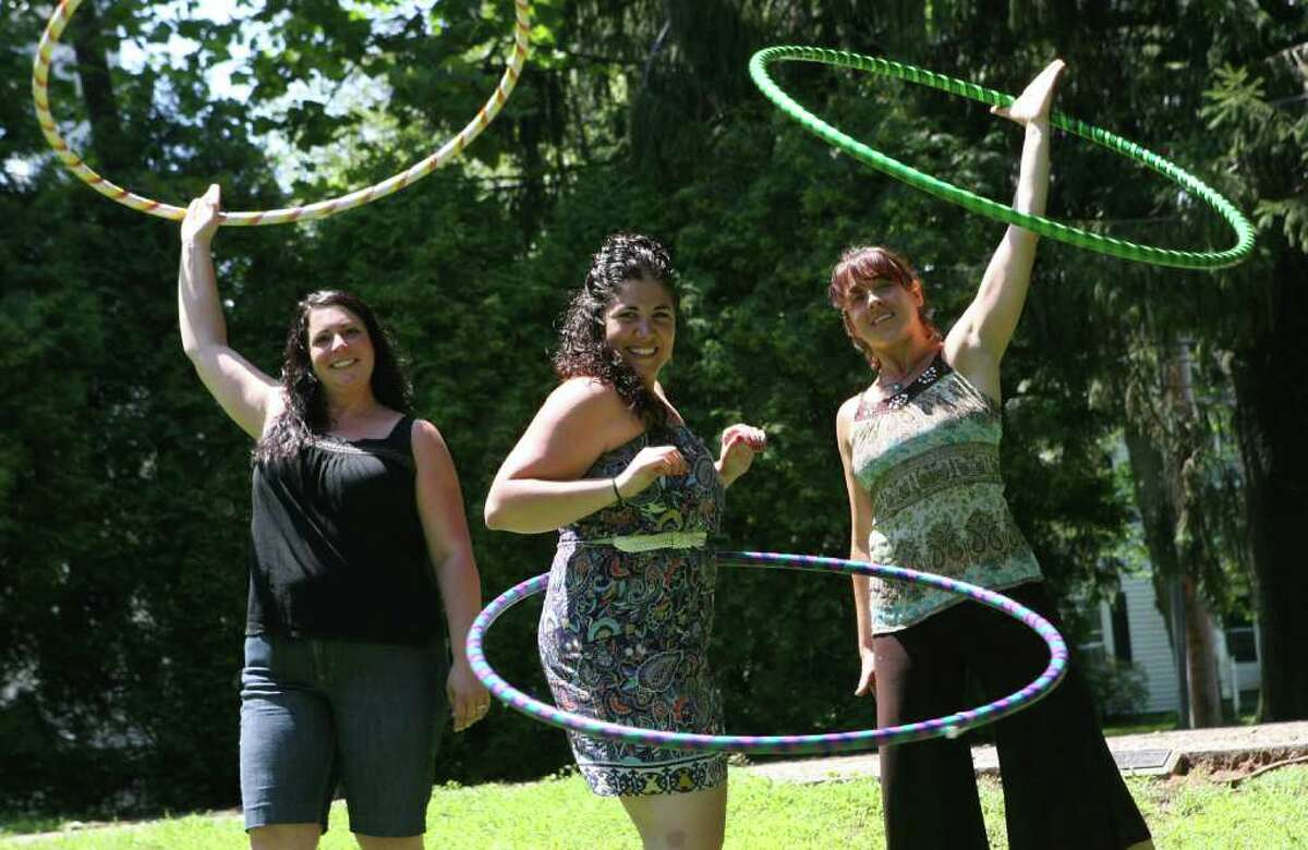 """""""bringtheHoopla"""" founders, from left, Jackie Far Ribalaigua, Nicole Heriot, and Jennifer DeBlasio, focus on education and fitness through hooping. They create their own hoops and run parties and classes. June 27, 2011."""