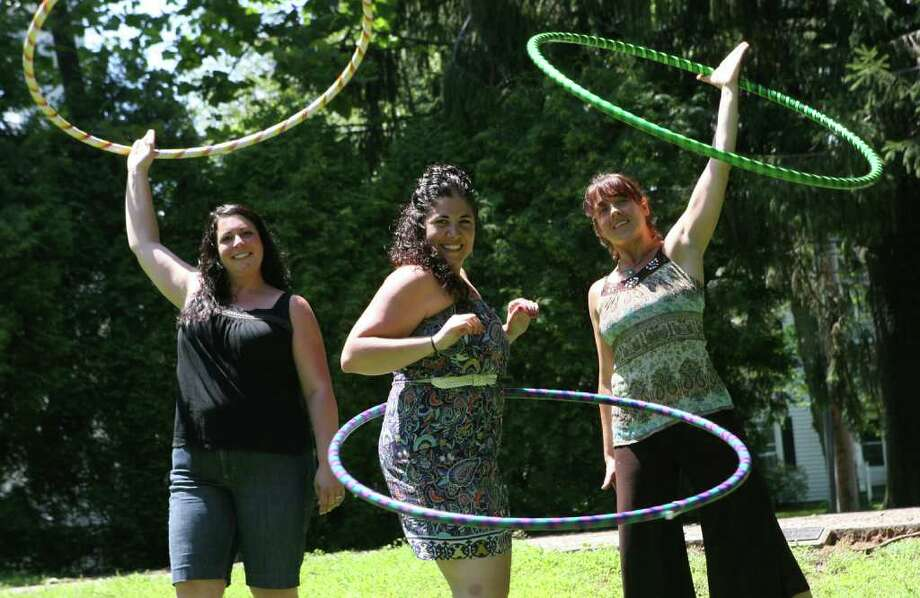 """""""bringtheHoopla"""" founders, from left, Jackie Far Ribalaigua, Nicole Heriot, and Jennifer DeBlasio, focus on education and fitness through hooping. They create their own hoops and run parties and classes. June 27, 2011. Photo: B.K. Angeletti / Connecticut Post"""