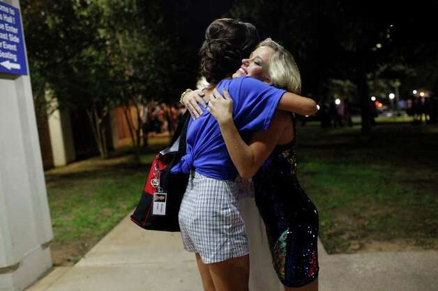 metro - Miss East Texas and San Antonio resident Jennifer Peter, right,  embraces Miss Austin Monique Evans after the third night of the Miss Texas Pageant preliminary competition at Texas Hall on the campus of the University of Texas at Arlington on Thursday, June 30, 2011. LISA KRANTZ/lkrantz@express-news.net Photo: LISA KRANTZ, SAN ANTONIO EXPRESS-NEWS / SAN ANTONIO EXPRESS-NEWS