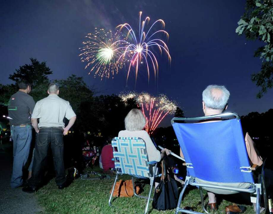 The crowd views the Town of Greenwich fireworks show at Binney Park, Old Greenwich, in 2010. Photo: File Photo / Greenwich Time File Photo