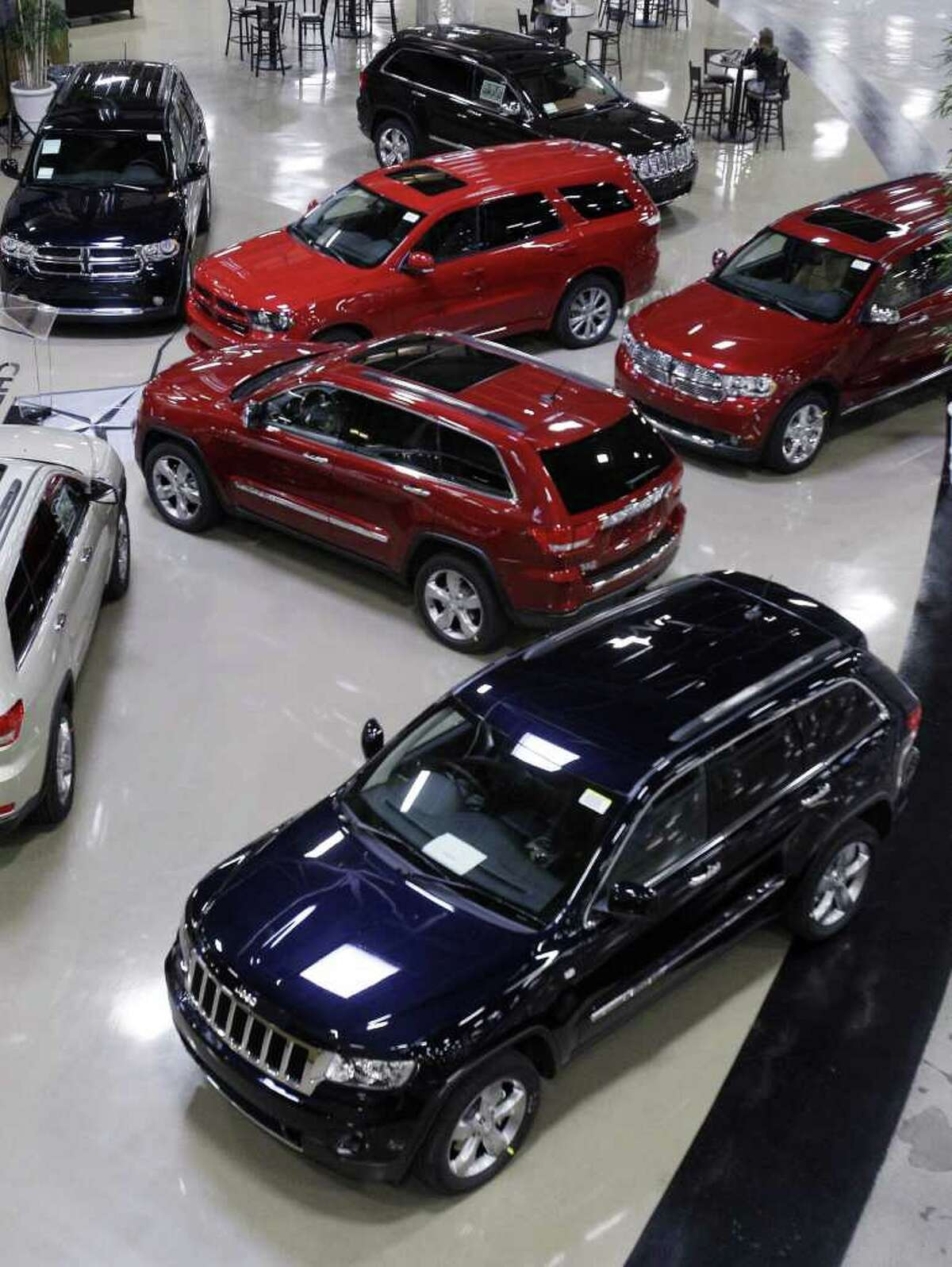 In this April 28, 2011 photo, 2012 Chrysler SUV's are displayed on the floor at Chrysler's Jefferson North Assembly Plant in Detroit. Chrysler Group LLC reported Friday, July 1, 2011, its retail sales surged 46 percent in June compared with same month a year ago; best retail sales month of the year.