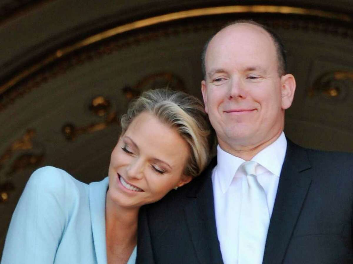 Prince Albert II of Monaco appears with his bride Charlene Princess of Monaco at the Monaco palace, after the civil wedding marriage ceremony, Friday, July 1, 2011. (AP Photo/Bruno Berbert, Pool)