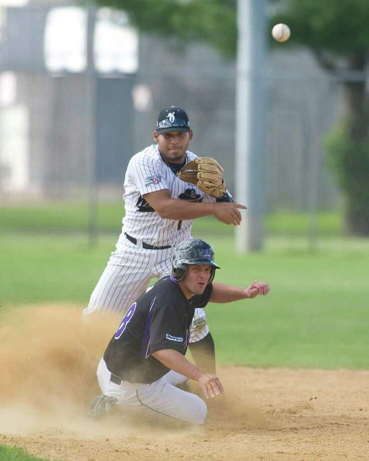 The Westerners' Sergio Perez turns a double play against the Keene Swamp Bats Friday at Rogers Park. Photo: Barry Horn