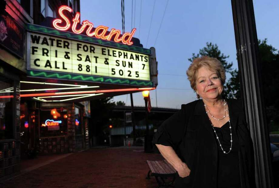 Jeri Swinik, Manager of the Strand Theater, poses in front of it along Main Street in Seymour, Conn. on Friday July 1, 2011. Photo: Christian Abraham / Connecticut Post