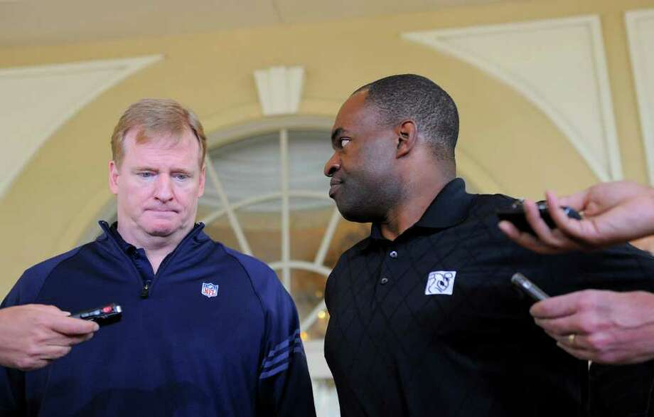 NFL commissioner Roger Goodell, left, and National Football League Players Association executive director DeMaurice Smith, right, speak to the media outside of the Ritz-Carlton hotel after addressing players during the NFLPA rookie symposium on Wednesday, June 29, 2011 in Sarasota, Fla. (AP Photo/Brian Blanco) Photo: Brian Blanco