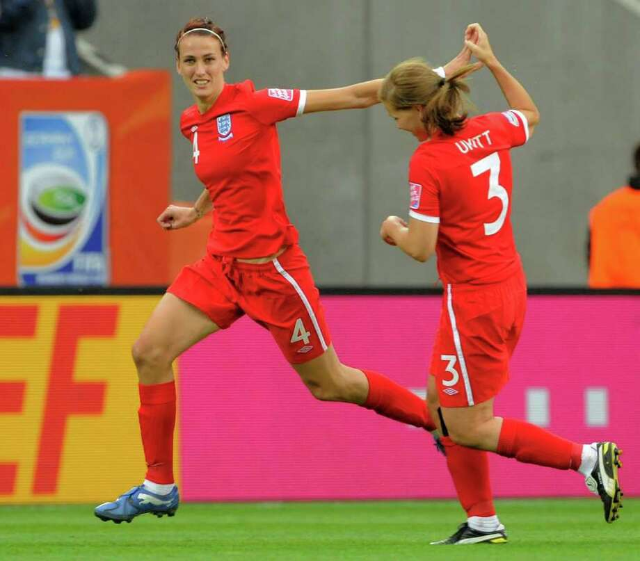 England's Jill Scott, left, celebrates scoring her side's first goal with teammate Rachel Unitt during the group B match between New Zealand and England at the Womenis Soccer World Cup in Dresden, Germany, Friday, July 1, 2011. (AP Photo/Jens Meyer) Photo: Jens Meyer